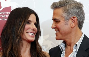 U.S. actor Clooney poses with actress Bullock during a photocall during the 70th Venice Film Festival in Venice